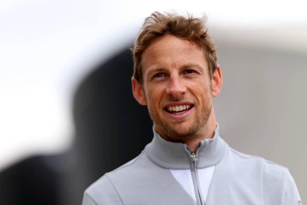 NORTHAMPTON, ENGLAND - JULY 05:  Jenson Button of Great Britain and McLaren walks through the paddock during qualifying ahead of the British Formula One Grand Prix at Silverstone Circuit on July 5, 2014 in Northampton, United Kingdom.  (Photo by Mark Thompson/Getty Images)