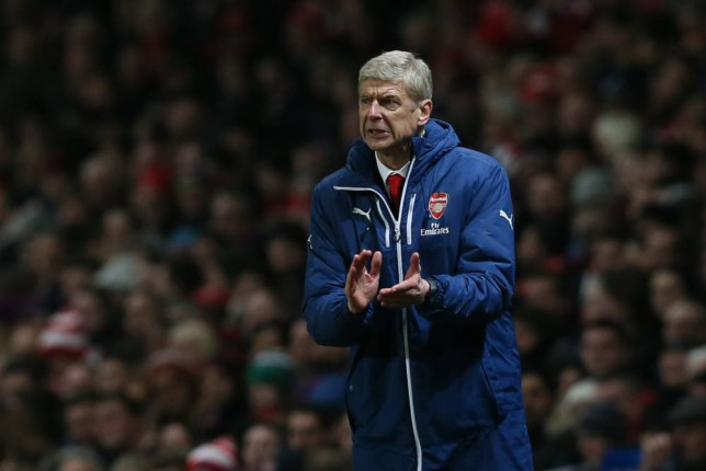 Arsenalís manager Arsene Wenger looks across the pitch during the English Premier League soccer match between Arsenal and Newcastle United at the Emirates Stadium, London, Saturday, Dec. 13, 2014. (AP Photo/Tim Ireland)