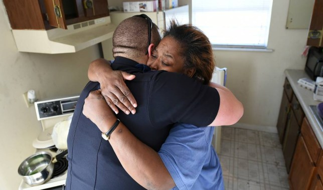 LANDOV via Press Association Images Helen Johnson thanks Tarrant Police officer William Stacy with a hug in her kitchen. Tarrant Police officers including Officer William Stacy deliver bags of food to Helen Johnson. Officer Stacy bought the one dozen eggs that Johnson stole from a local store and didn't arrest her.  The act to kindness was recorded and Johnson says it changed her life.       AL.COM /Landov