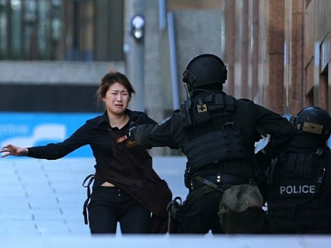 Sydney siege: Lights go out at cafe as gunman orders hostages to call media