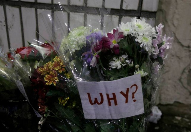 Flowers laid at the scene in George Square, Glasgow where a bin lorry crashed into a group of pedestrians which has left six people dead. PRESS ASSOCIATION Photo. Picture date: Tuesday December 23, 2014. See PA story POLICE Lorry. Photo credit should read: Danny Lawson/PA Wire