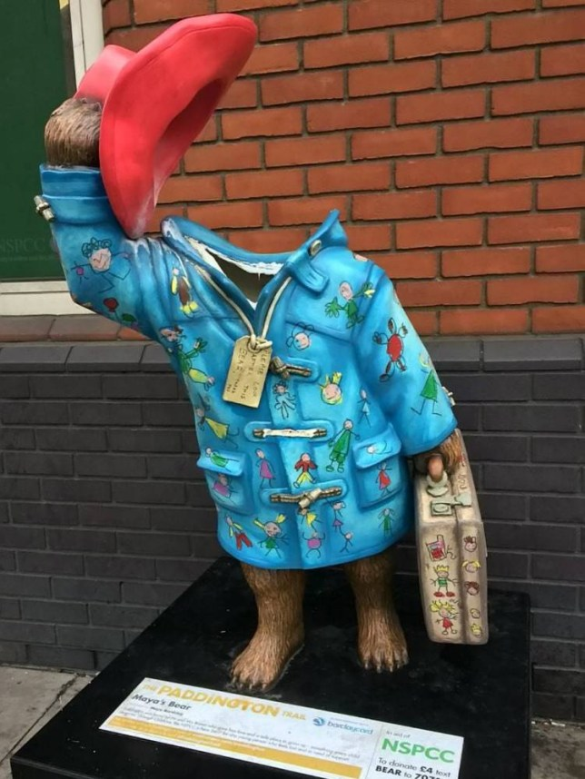 Pictured is the vandalised Paddington Bear statue designed by a competition winning 13-year-old girl for a charity fundraiser entered by Kate Moss and Stephen Fry. The beloved statue designed by competition winner Maya was due to be auctioned to raise funds for children's charity NSPCC but was found on Sunday with its head missing. See SWNS Story SWBEAR. Maya's bear was part of the charity's Paddington Trail where 50 statues designed by stars including Alan Shearer and Emma Watson were being displayed on the capital's streets.  But Maya's statue was discovered headless outside the NSPCC headquarters in Shoreditch, east London, on Sunday morning after thugs performed a gross act of vandalism on it.  The decapitation of the bear, which was due to be displayed until December 30, sparked outrage and triggered a campaign to find the head. 23 December 2014