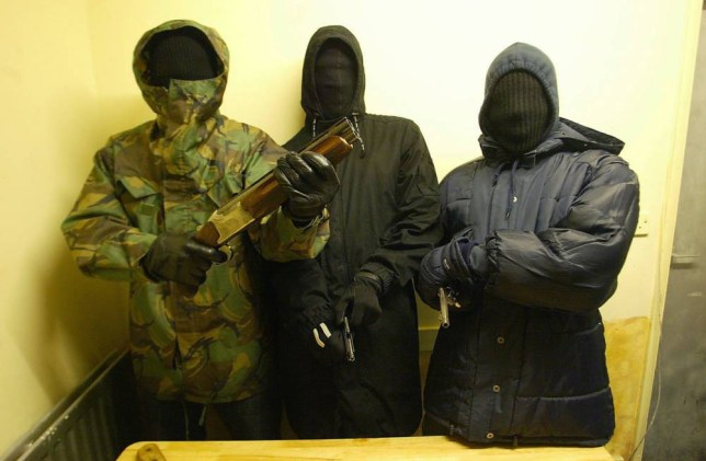 Some hooded members of the Burger Bar Boys gang holding some of their weapons. Other members of the same gang are alleged to have killed teenage girls Letisha Shakespeare 18, and Charlene Ellis 17,  in a hail of bulletts in early January 2003. News Team International 12/01/2003 Pic by Steve Pond .