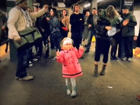 Little girl instigates impromptu dance party on subway platform