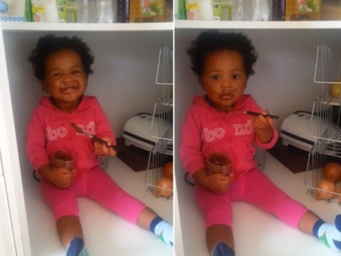 Adorable little girl hides in the cupboard to eat Nutella straight from the jar (because Nutella)