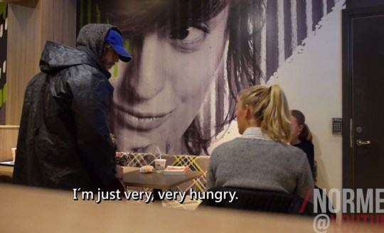 Some let the homeless man take the food (Picture: YouTube)