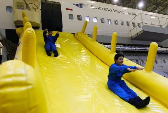 If you listen to the plane's safety briefing, you will learn that this slide is for emergencies only (Picture: Rex)