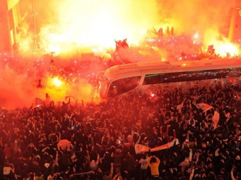Real Madrid fans create crazy scenes before Atletico Madrid clash after lighting flares to greet team bus