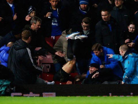 Andy Carroll breaks chair after going flying into the crowd during West Ham's FA Cup replay against Everton
