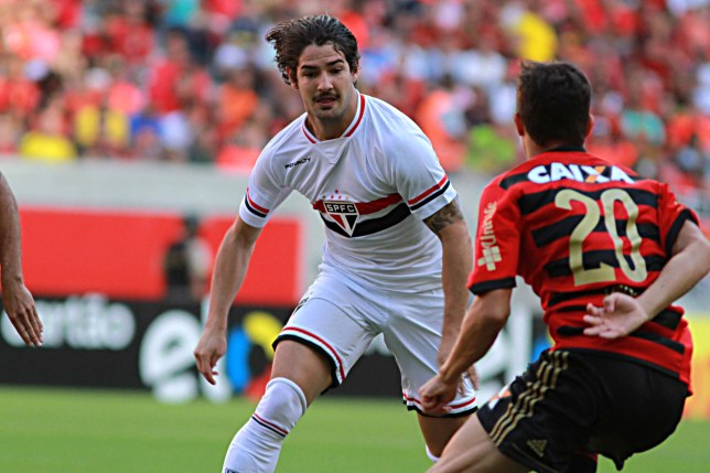 RECIFE, BRAZIL - DECEMBER 07: Mike of Sport Recife battles for the ball with Alexandre Pato of Sao Paulo during the Brasileirao Series A 2014 match between Sport Recife and Sao Paulo at Arena Pernambuco Stadium on November 07, 2014 in Recife, Brazil. (Photo by Renato Spencer/Getty Images)