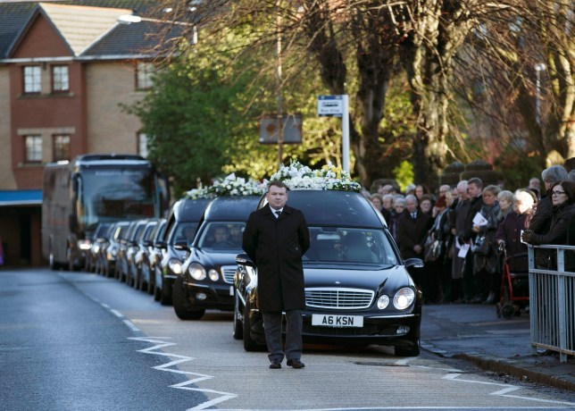 Hearses carry the coffins after a requiem mass (Picture: EPA)