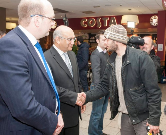 Romanian migrants arriving at Luton Airport on the first day since the lifting  of travel restrictions.  MPs Mark Reckless (left) and Keith Vaz welcome Victor Spirescu, 30.