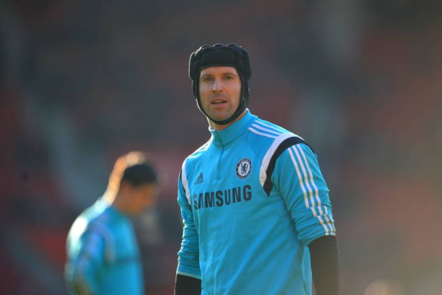 Chelsea's Czech goalkeeper Petr Cech warms-up ahead of the English Premier League football match between Southampton and Chelsea at St Mary's Stadium in Southampton, southern England, on December 28, 2014. AFP PHOTO / GLYN KIRK  RESTRICTED TO EDITORIAL USE. No use with unauthorized audio, video, data, fixture lists, club/league logos or live services. Online in-match use limited to 45 images, no video emulation. No use in betting, games or single club/league/player publications.GLYN KIRK/AFP/Getty Images