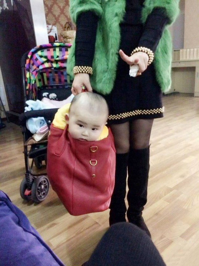 "Pic shows: A Chinese mum carries her baby son around like a pet dog in a designer handbag.nnThis photograph by a Chinese mum of her baby son being carried around like a pet dog in a designer handbag has caused outrage and debate after it went viral.nnXue Hsueh, 26, had been off to meet friends and one of her pals took a snap of her nine-month-old son which she sent to Xue, who liked it so much she uploaded it online.nnBut it quickly became widely shared where many commented on the fact that last year young women liked to be seen with lapdogs to complete their outfits, and now the trend seemed to be for babies.nnUser WuLei34 posted: ""Designer babies, the latest accessory that every woman must have.""nnAnd another LucyX added: ""I wonder what she will do when the straps break on her handbag?""nnHowever a defiant Xue defended the pictures, posting online that the baby had only been in the handbag briefly while she chatted to her friends and said she had been making a joke about how men usually look after babies.nnShe said she had just wanted to illustrate what childcare would be like if it was left to a man, and posted the pictures online because they look sweet and to raise a smile.nnShe also said that it was clear that her son thought it was fun being in the bag and the picture showed he was enjoying himself.nn(ends)n"
