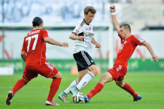 Legia Warszaw's  Krystian Bielik and Piast Gliwice's Kamil Wilczek battle for the ball.