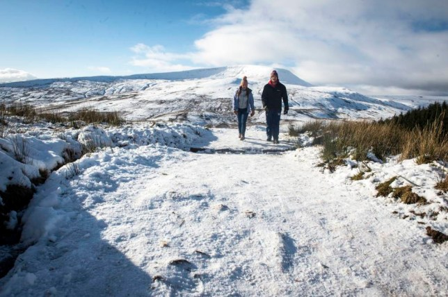 People walk over the snow covered mountain of Pen y fan, the highest peak in south Wales, situated in the Brecon Beacons National Park and standing at 886 metres above sea-level. PRESS ASSOCIATION Photo. Picture date: Sunday January, 18, 2015. Photo credit should read: Ben Birchall/PA Wire