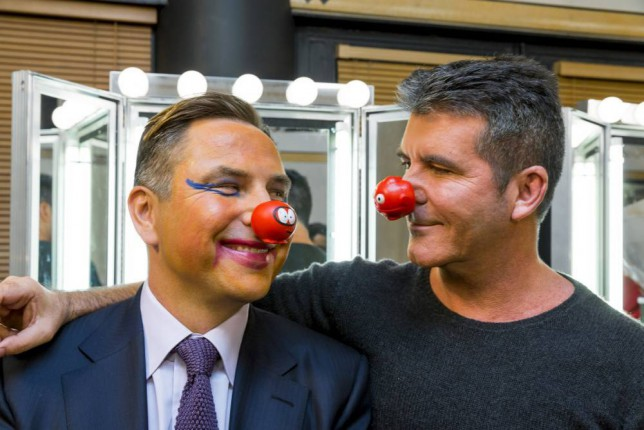 Undated Comic Relief handout photo of David Walliams and Simon Cowell encouraging the public to make your face funny for money in aid of Comic Relief. PRESS ASSOCIATION Photo. Issue date: Monday January 26, 2015. See PA story SHOWBIZ Relief. Photo credit should read: Tom Dymond/Comic Relief/PA Wire NOTE TO EDITORS: This handout photo may only be used in for editorial reporting purposes for the contemporaneous illustration of events, things or the people in the image or facts mentioned in the caption. Reuse of the picture may require further permission from the copyright holder.