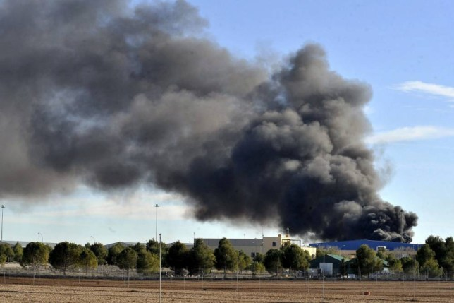 epa04586498 Smoke rises after a Greek F-16 aircraft crashed at Los Llanos air base in Albacete, eastern Spain, 26 January 2015. The two pilots have been reported dead and other 10 people have been injured following the accident. The plane was taking part in the NATO's Tactical Leadership Programme (TLP) based at Los Llanos.  EPA/MANU