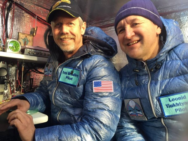 This Jan. 8, 2015 photo provided by Tami Bradley-Two Eagles Balloon Team, shows pilots from left, Troy Bradley of Albuquerque, N.M., and Leonid Tiukhtyaev of Russia, before they lift off in a gas balloon in Saga, Japan.  The Two Eagles pilots have traveled farther and longer in a gas balloon than anyone in history in a bid to remove the qualifiers that have complicated a century of record keeping in long-distance ballooning. Now they're aiming for a safe landing on the beaches of Baja California.  (AP Photo/Tami Bradley-Two Eagles Balloon Team)