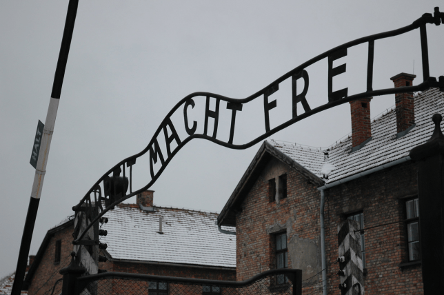 Inmates at Auschwitz were greeted with the ironic 'Arbeit Macht Frei' sign (Picture: Wikicommons)