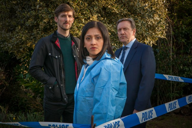 BENTLEY PRODUCTIONS FOR ITV MIDSOMER MURDERS EPISODE 1 HABEAS CORPUS Pictured: GWILYM LEE as DS Charlie nelson, MANJINDER VIRK as Dr Kam Karimore and NEIL DUDGEON as DCI John Barnaby. Photographer Mark Bourdillon. This image is the copyright of Bentley Productions and is only to be used in relation to Midsomer Murders.