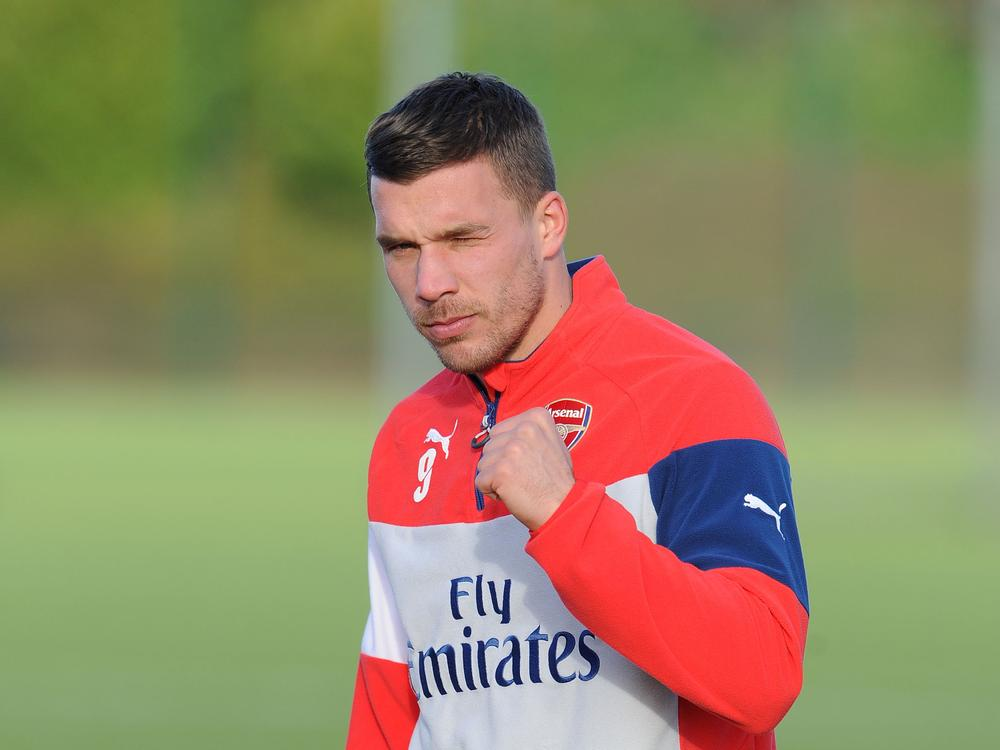 Lukas Podolski rubbishes claims he stormed out of training over Arsenal transfer row