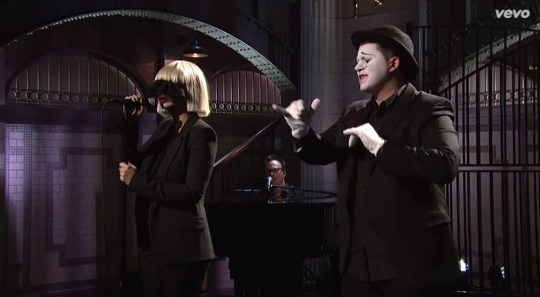 Sia partnered with mime artist to give an emotive rendition of her hit Chandelier on Saturday Night Live