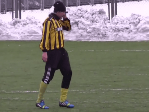 Ukrainian defender Oleh Makarov answers his mobile phone DURING game for FC Enerhiya Nova Kakhovka