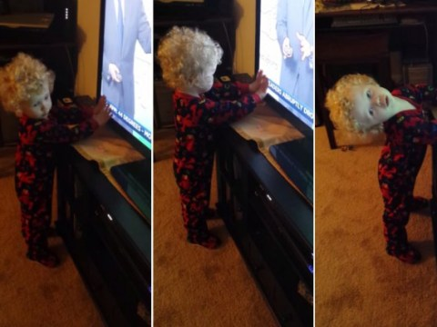 Little boy valiantly tries to stop words scrolling across his TV