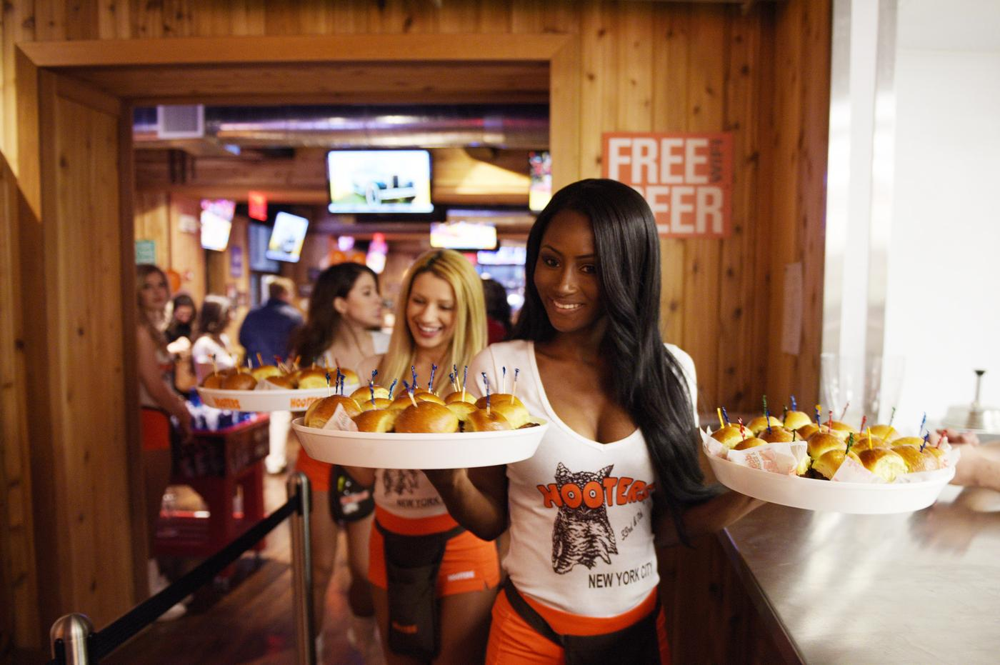 NEW YORK, NY - JANUARY 15: Hooters girls attend Hooters Manhattan VIP Press Party at Hooters Manhattan on January 15, 2015 in New York City. Grant Lamos IV/Getty Images