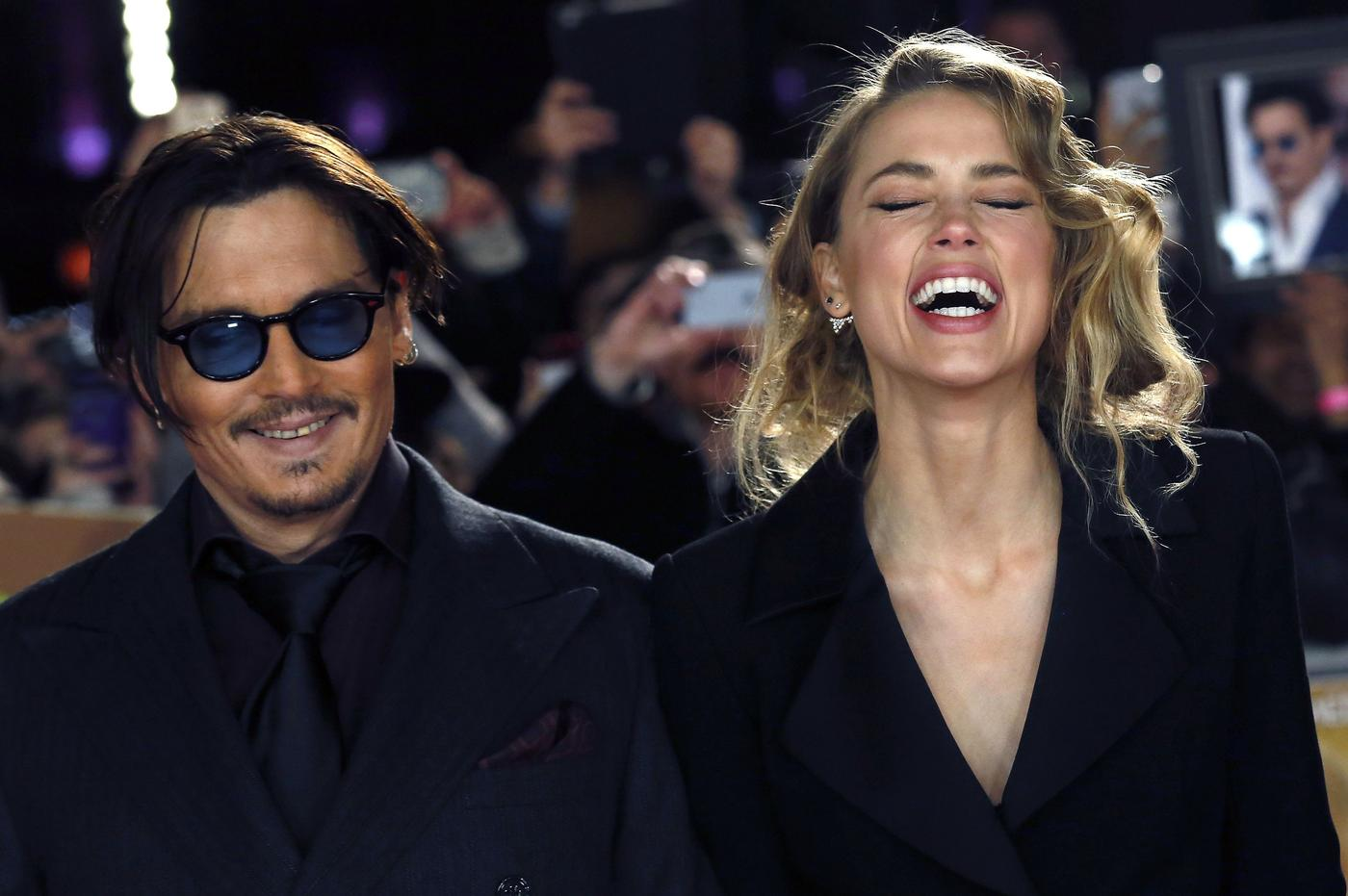 Amber Heard's restraining order against Johnny Depp has been extended for two months