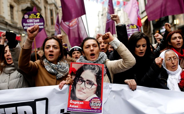 Turkish women shout slogans against the murder of a woman as they hold a picture of Ozgecan Aslan who was raped and killed by three suspects in Mersin city (Picture: AP)