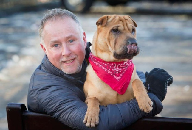 Kai the dog with his new owner Ian Russell at a Scottish SPCA office in Glasgow, after he was abandoned at a railway station with a suitcase full of his belongings. PRESS ASSOCIATION Photo. Picture date: Wednesday February 4, 2015. Kai attracted worldwide attention after he was dumped at Ayr station last month, prompting offers from dog lovers around the globe to take him in. He was rescued by the Scottish SPCA, and the charity chose Ian Russell, 52, from a list of hundreds to give the shar pei-crossbeed a new start in life. See PA story ANIMALS Dog. Photo credit should read: Danny Lawson/PA Wire