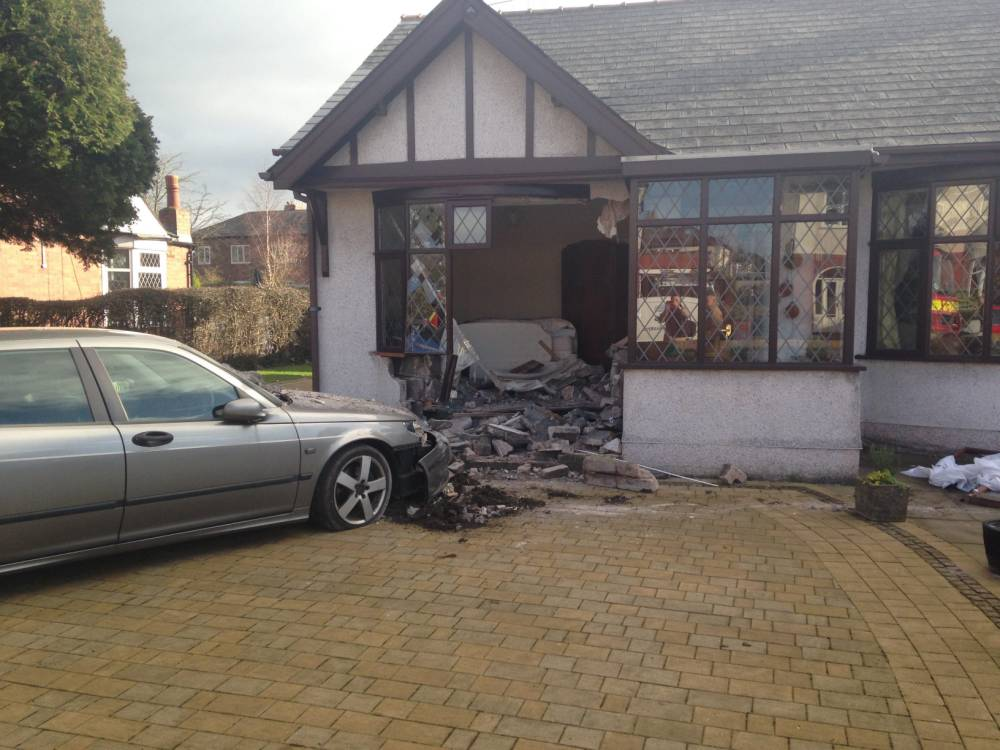 Scene picture where Derrick Rissley crashed his car into his own front room in Preston when he accidentally pressed accelerator instead of brake. RPYCRASH : A pensioner was pulled from his car wreckage after he nearly bulldozed his  HOUSE. Silver-haired Derrick Rissley flirted with death when his grey Saab plunged through his bungalow window after accidentally hitting the gas instead of brakes. The hapless driver was pulled from the rubble by a heroic decorator after the smash in Fulwood, Lancs. Neighbour David Wells, 75, heard a loud noise when his decorator sprinted across the street to save the crash victim.