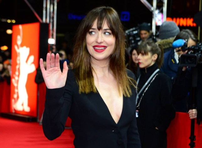 US actress Dakota Johnson poses for photographers on the red carpet prior to the screening of Fifty 'Shades of Grey' as part of Berlinale Special Gala at the 65th Berlin International Film Festival Berlinale in Berlin, on February 11, 2015.     AFP PHOTO / JOHN MACDOUGALLJOHN MACDOUGALL/AFP/Getty Images