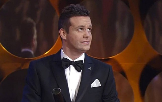 """Pic shows: Fake Jim Carrey at the ceremony in Prague on 21st February.nnOrganisers of a film festival in the Czech Republic have admitted being dumb and dumber after organising VIP red carpet treatment for a conman who claimed to be funnyman Jim Carrey.nnThey even arranged for the con artist to be allowed on stage where he was greeted by applause from the audience, some who clearly realised that it was not the real Jim Carey, and after waving and being showered in golden confetti, he had then left the stage.nnOrganizers of the Czech Lion Awards (Cesky lev) had been contacted by the alleged management of the star who said he was in the area, and would like to come by. The Czech Lions are the equivalent to the Academy Awards in the Czech Republic, and the 'management' said it would be an honour for Jim Carrey to be allowed to attend.nnThey were asked not to make public that he had been invited until his appearance, because of security concerns, and organisers of the event had readily agreed.nnBut after widespread criticism with the organisers being bombarded with notes from fans pointing out that the Jim Carrey on the stage was a fake, they finally accepted that a mistake been made. However the embarrassing appearance had already been broadcast live countrywide on Czech television.nnFilm director Jan Sverak, who supervised the ceremony, said: """"We have become very likely the target of a very elaborate hoax. I'm so sorry.""""nnIt was even more embarrassing as a climbdown because he and the organisers had earlier insisted that it was the real Jim Carey who appeared. Even the award host Lucie Vyborna had insisted he was real, telling Czech newspaper Blesk shortly after the ceremony: """"Of course the real Jim Carrey was on the stage. I knew that he would come but I did not know what he would do there. He appeared for a very short time and people did not have chance to recognise him. I have heard people suggesting it was a lookalike but I can say no, it was really him.""""nnBut aft"""