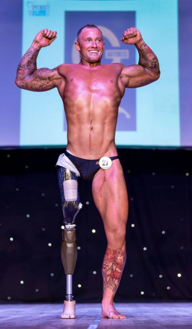 Bodybuilder Mark Smith who has won prizes for his physique - despite losing a leg in Afghanistan. See SWNS story SWBODY; An Afghan veteran who lost a leg during a shooting accident has transformed himself -- into a champion BODY BUILDER. Hero soldier Mark Smith, 30, was lucky to survive after being shot twice and had to have his entire right leg amputated after the bullet severed his femoral artery. But the former Grenadier Guard - who served in Bosnia, Iraq and Afghanistan - wanted to be a role model to his sons and took up body building. The dad-of-two hit the weights and was soon outstripping able-bodied gym goers, lifting 100 kilos through his left leg and 220 kilos on the leg press with his prosthetic.