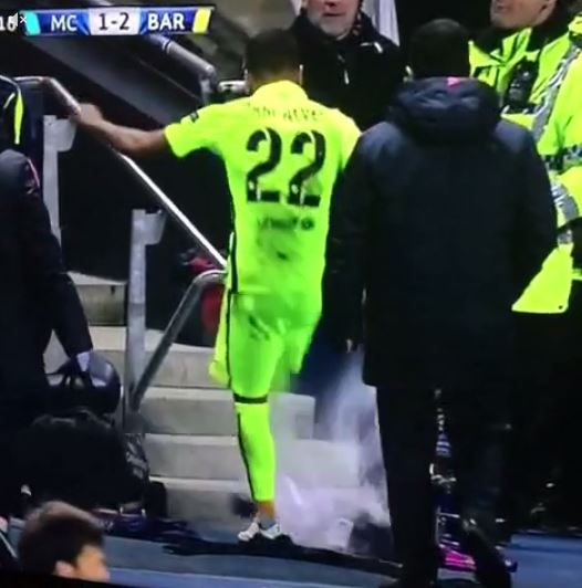 Barcelona's Dani Alves takes frustration at being substituted during Manchester City Champions League clash out on innocent water bottle