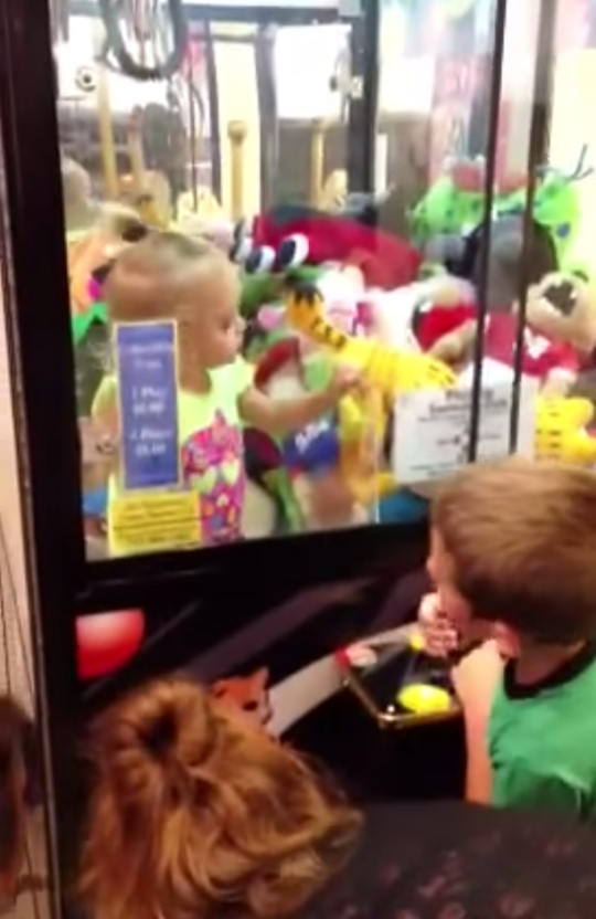 Seen here: The 'get out of that arcade you!' technique (Picture: Youtube)