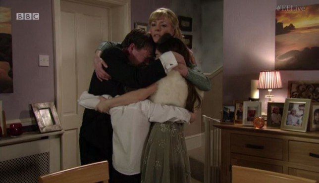 Peter, Cindy, Jane and Ian Beale hug at the end of the eastenders live episode 2015
