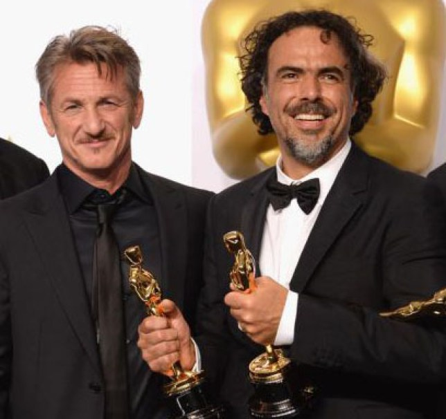 HOLLYWOOD, CA - FEBRUARY 22: (L-R) Alejandro Gonzalez Inarritu and actor Sean Penn pose in the press room during the 87th Annual Academy Awards at Loews Hollywood Hotel on February 22, 2015 in Hollywood, California. Jeff Kravitz/FilmMagic