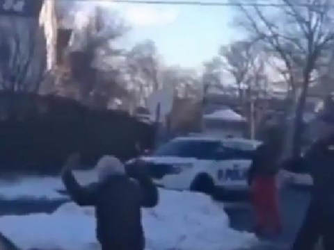 Teens held at gunpoint by police officer for 'having a snowball fight'