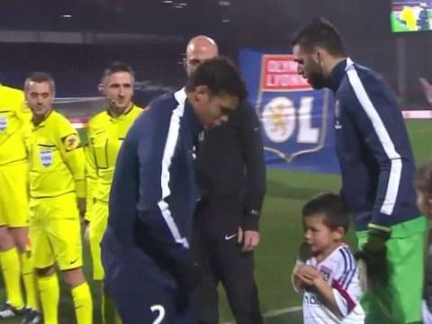 Paris Saint-Germain's Thiago Silva gives jacket to frozen Lyon mascot