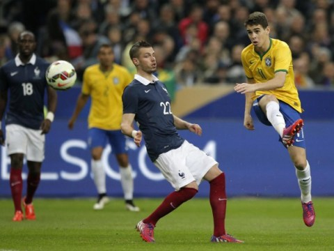 Chelsea midfielder Oscar nutmegs France goalkeeper Steve Mandanda to score in Brazil's friendly win