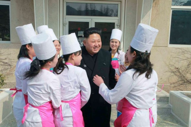 North Korean leader Kim Jong Un smiles during his inspection of Unit 1016 of KPA (Korean People's Army) Air and Anti-Air Force honored with the Title of O Jung Hup-led 7th Regiment, in this undated photo released by North Korea's Korean Central News Agency (KCNA) in Pyongyang March 9, 2015. REUTERS/KCNA (NORTH KOREA - Tags: POLITICS TPX IMAGES OF THE DAY) ATTENTION EDITORS - THIS PICTURE WAS PROVIDED BY A THIRD PARTY. REUTERS IS UNABLE TO INDEPENDENTLY VERIFY THE AUTHENTICITY, CONTENT, LOCATION OR DATE OF THIS IMAGE. FOR EDITORIAL USE ONLY. NOT FOR SALE FOR MARKETING OR ADVERTISING CAMPAIGNS. THIS PICTURE IS DISTRIBUTED EXACTLY AS RECEIVED BY REUTERS, AS A SERVICE TO CLIENTS. NO THIRD PARTY SALES. NOT FOR USE BY REUTERS THIRD PARTY DISTRIBUTORS. SOUTH KOREA OUT. NO COMMERCIAL OR EDITORIAL SALES IN SOUTH KOREA