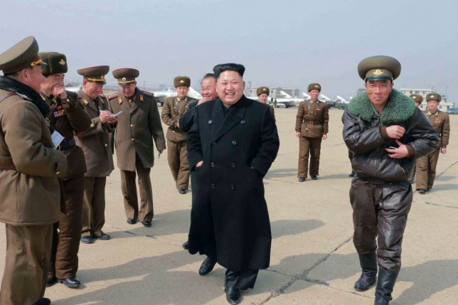 North Korean leader Kim Jong Un (C) inspects Unit 1016 of KPA (Korean People's Army) Air and Anti-Air Force honored with the Title of O Jung Hup-led 7th Regiment, in this undated photo released by North Korea's Korean Central News Agency (KCNA) in Pyongyang March 9, 2015. REUTERS/KCNA (NORTH KOREA - Tags: POLITICS) ATTENTION EDITORS - THIS PICTURE WAS PROVIDED BY A THIRD PARTY. REUTERS IS UNABLE TO INDEPENDENTLY VERIFY THE AUTHENTICITY, CONTENT, LOCATION OR DATE OF THIS IMAGE. FOR EDITORIAL USE ONLY. NOT FOR SALE FOR MARKETING OR ADVERTISING CAMPAIGNS. THIS PICTURE IS DISTRIBUTED EXACTLY AS RECEIVED BY REUTERS, AS A SERVICE TO CLIENTS. NO THIRD PARTY SALES. NOT FOR USE BY REUTERS THIRD PARTY DISTRIBUTORS. SOUTH KOREA OUT. NO COMMERCIAL OR EDITORIAL SALES IN SOUTH KOREA