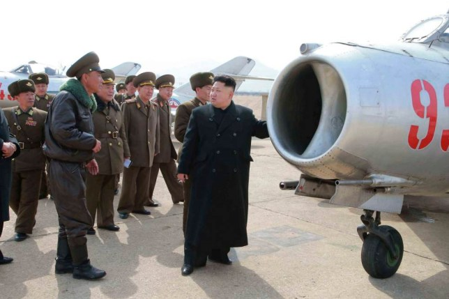 North Korean leader Kim Jong Un inspects Unit 1016 of KPA (Korean People's Army) Air and Anti-Air Force honored with the Title of O Jung Hup-led 7th Regiment, in this undated photo released by North Korea's Korean Central News Agency (KCNA) in Pyongyang March 9, 2015. REUTERS/KCNA (NORTH KOREA - Tags: POLITICS) ATTENTION EDITORS - THIS PICTURE WAS PROVIDED BY A THIRD PARTY. REUTERS IS UNABLE TO INDEPENDENTLY VERIFY THE AUTHENTICITY, CONTENT, LOCATION OR DATE OF THIS IMAGE. FOR EDITORIAL USE ONLY. NOT FOR SALE FOR MARKETING OR ADVERTISING CAMPAIGNS. THIS PICTURE IS DISTRIBUTED EXACTLY AS RECEIVED BY REUTERS, AS A SERVICE TO CLIENTS. NO THIRD PARTY SALES. NOT FOR USE BY REUTERS THIRD PARTY DISTRIBUTORS. SOUTH KOREA OUT. NO COMMERCIAL OR EDITORIAL SALES IN SOUTH KOREA