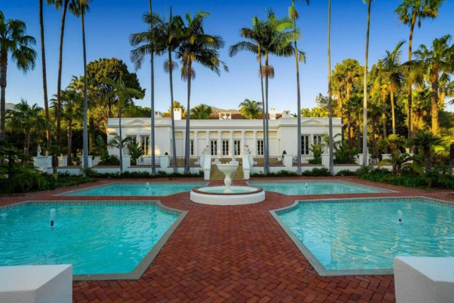 PIC FROM CATERS NEWS - (PICTURED: The magnificent exterior of the property ) - The incredible house used as the location for Al Pacinos home in the film Scarface has gone on sale. Huge mansion El Fureidis in Montecito, California was the location for the wedding between Pacinos Tony and Michelle Pfeiffers Elvira in the 80s mobster classic. But the wannabe gangsters will have to cough up more than just a few fistfuls of cash as the price tag is a whopping 23 million. SEE CATERS COPY.