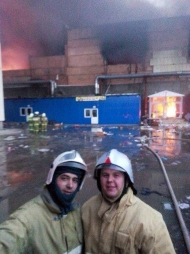 "Pic shows: Russian firemen Ilya Bykov and Rostislav Krylov took a selfie of themselves standing in front of a blazing building in which 17 people were killed.nnRussian firemen who took a selfie of themselves standing in front of a blazing building in which 17 people were killed are facing the sack.nnIlya Bykov, 30, and Rostislav Krylov, 28, had been called to the shopping centre inferno in the city of Kazan in the central Russian Republic of Tatarstan, after it broke out last week killing 17 and seriously injuring 55 including two policemen and two emergency workers.nnThe fire, which is thought to have started in a cafe next door to the complex on March 11, was at first tackled by a lone security guard.nnBut as it raged out of control he phoned the emergency services as horrified shoppers fled in terror.nnNow it has emerged that two of the firemen called to the scene were busy taking the selfies.nnAppearing on the social networking site VKontakt, the Russian equivalent of Facebook, the two men are seen smiling as flames engulf the building behind them.nnHorrified viewer Yegor Tokaryev posted: ""Christ! People are dying in there and these men are smiling and taking photos!! They are there to save lives.""nnAnother disgusted viewer Svetlana Kapustina wrote: ""It makes me sick to think that while those poor people were burning to death these two were treating it as some sort of joke.nn""Shame on them.""nnNow authorities say they are looking into the photos and may take disciplinary steps.nnA spokesman for the Regional Emergency Situations Department said: ""Most to the emergency workers called to the scene did their job competently and efficiently.nn""These two are not characteristic of those who work hard every day, tirelessly saving lives.nn""We are looking into the circumstances behind the photo and if it is found that the actions of these two firemen put people's lives at risk they shall be fired and criminal proceedings brought against them.""nn(ends)n"
