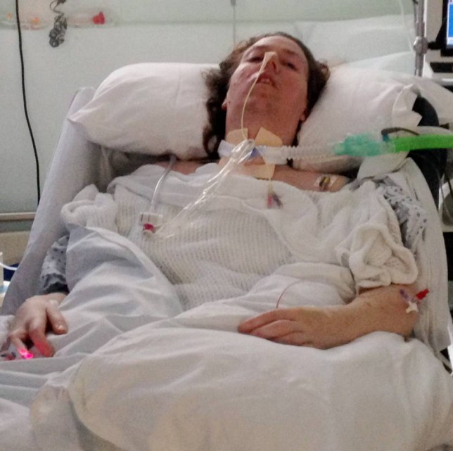 Jenny Bone pictured in Luton and Dunstable Hospital during the time she spent in a coma.  See MASONS story MNCOMA: A mother heard doctors ask permission from her family CHECK to switch off her life support system when she was in a coma. Jenny Bone, 39, collapsed on the floor of an empty tower block with pins and needles and was unable to get up a year ago. She made it to her GP in Leighton Buzzard, Beds., where she was diagnosed with rare autoimmune disease of the nervous system Guillain-Barre Syndrome. The debilitating condition left her paralysed and she was left in a coma at Luton and Dunstable Hospital.